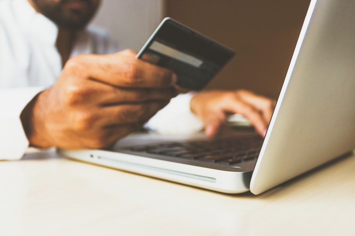 man entering credit card info on computer to pay divorce attorney