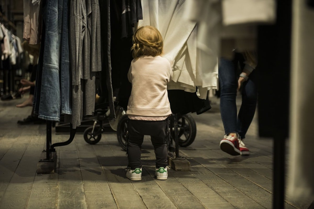 child shopping for clothes